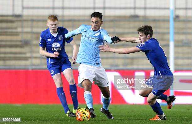 Manchester City's David Faupala battles for the ball with Everton's Joe Williams