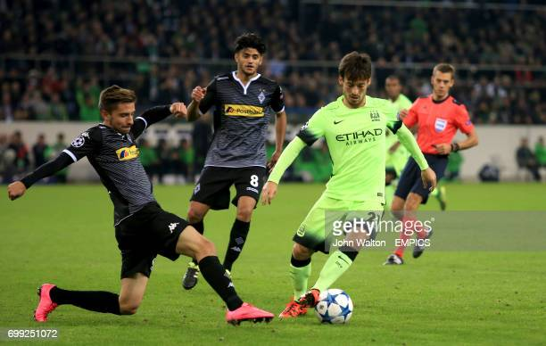 Manchester City's David Silva and Borussia Monchengladbach's Julian Korb battle for the ball