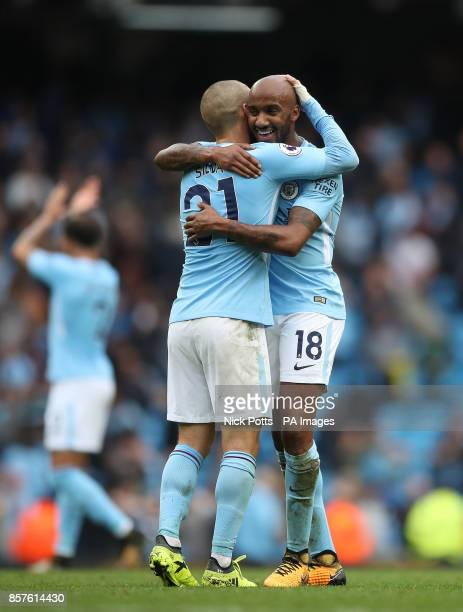 Manchester City's David Silva and Fabian Delph celebrate after the game