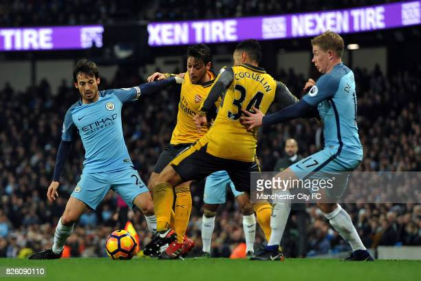 Manchester City's David Silva and Kevin De Bruyne and Arsenal's Mesut Ozil and Francis Coquelin in action during the Barclay's Premiership match at...