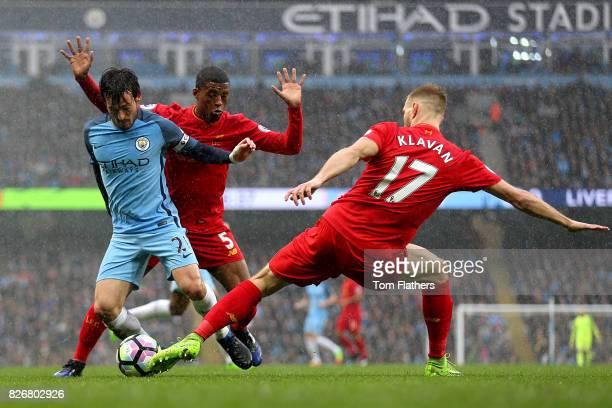Manchester City's David Silva and Liverpool's Ragnar Klavan battle for the ball