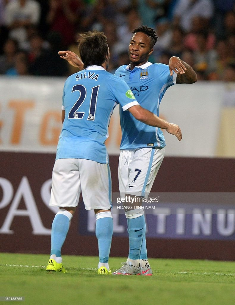 Manchester City s David Silva L and Raheem Sterling celebrate