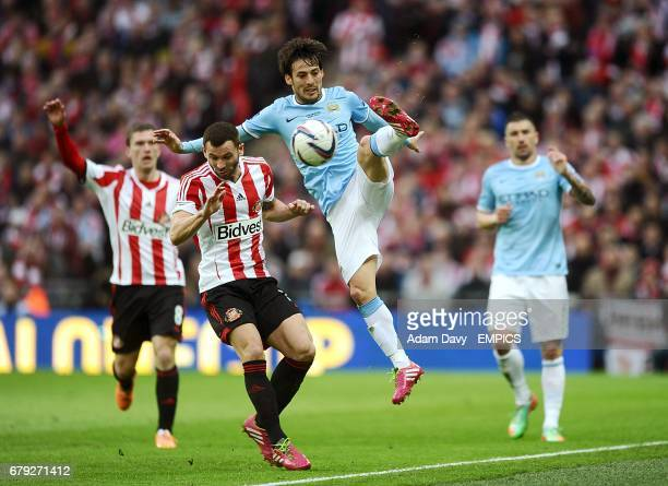 Manchester City's David Silva and Sunderland's Phil Bardsley in action