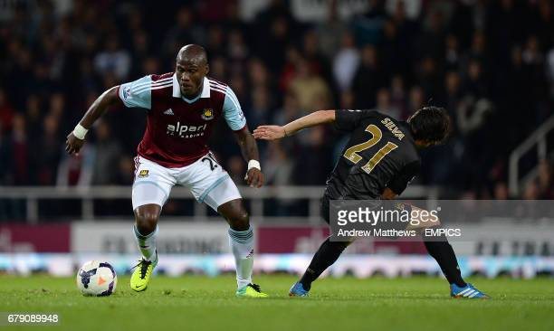 Manchester City's David Silva and West Ham United's Guy Demel battle for the ball