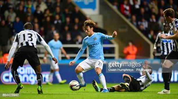 Manchester City's David Silva attempts to evade the tackle from Newcastle United's Yohan Cabaye