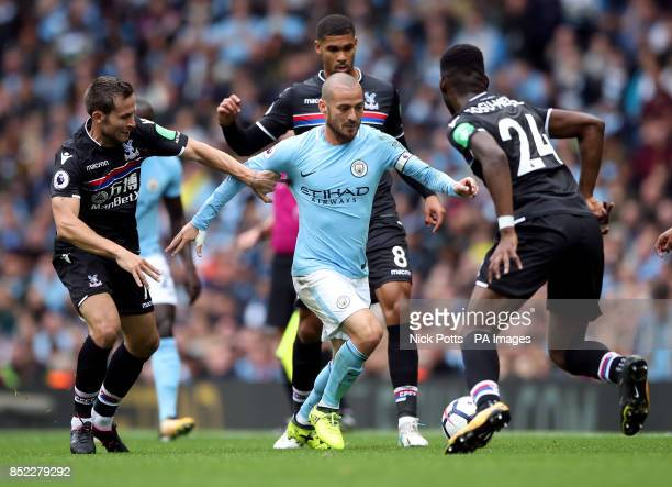 Manchester City's David Silva battles for the ball with Crystal Palace's Yohan Cabaye and Timothy FosuMensah during the Premier League match at the...