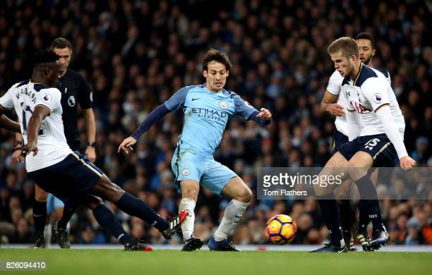 Manchester City's David Silva battles for the ball with Tottenham Hotspur's Victor Wanyama and Eric Dier
