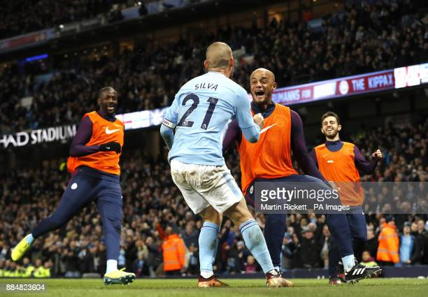 Manchester City's David Silva celebrates scoring his side's second goal of the game with team mate Vincent Kompany during the Premier League match at...