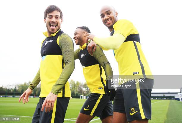 Manchester City's David Silva Raheem Sterling and fabian Delph walking to training