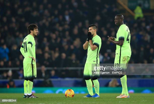 Manchester City's David Silva Sergio Aguero and Yaya Toure stand dejected after conceeding a second goal