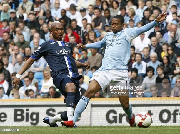Manchester City's De Souza Robinho and Blackburn Rovers' ElHadji Diouf battle for the ball