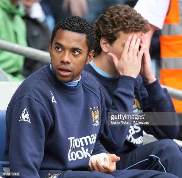 Manchester City's De Souza Robinho and Blumer Elano on the bench