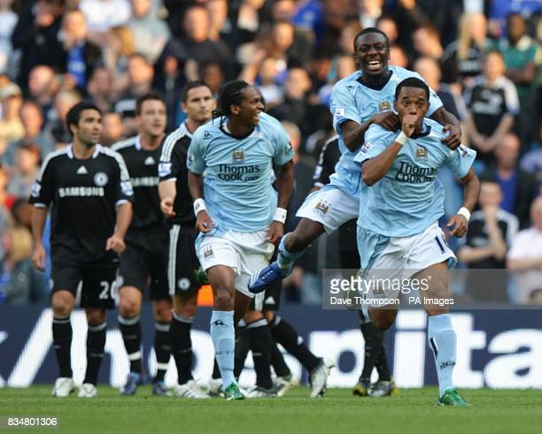 Manchester City's De Souza Robinho celebrates after scoring the opening goal of the game on his debut