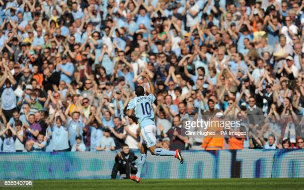Manchester City's De Souza Robinho celebrates in front of the home crowd after he scores the opening goal of the game