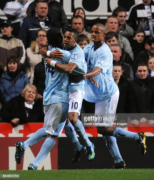 Manchester City's De Souza Robinho celebrates scoring his sides opening goal from the penalty spot with teammates Vincent Kompany and Joao Alves Jo