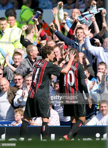 Manchester City's De Souza Robinho celebrates scoring the opening goal with Blumer Elano