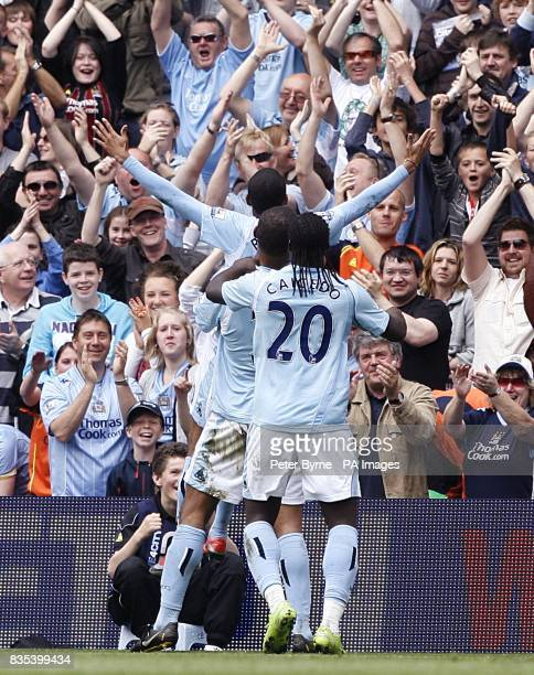 Manchester City's De Souza Robinho celebrates scoring the opening goal with his team mates