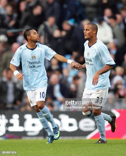 Manchester City's De Souza Robinho celebrates scoring the second goal of the game with team mate Vincent Kompany