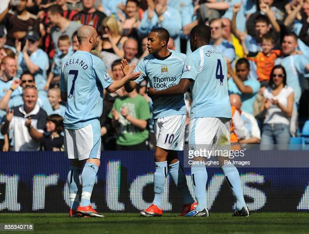 Manchester City's De Souza Robinho is congratulated by team mates Stephen ireland and Nedum Onuoha after he scores the opening goal of the game