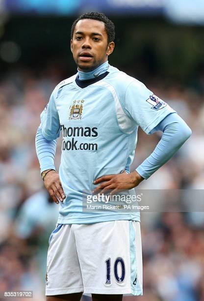 Manchester City's De Souza Robinho stands dejected after Fulham's Clint Dempsey scores the third goal