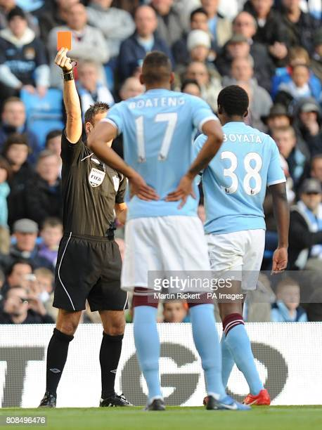 Manchester City's Dedryk Boyata is sent off by referee Mark Clattenburg after a challenge on Arsenal's Marouane Chamakh