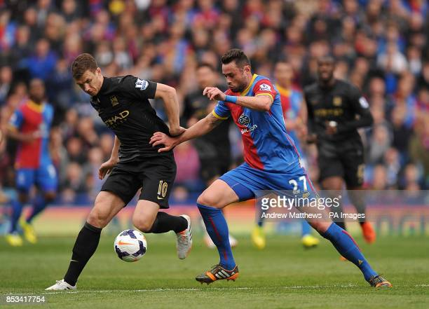 Manchester City's Edin Dzeko and Crystal Palace's Damien Delaney battle for the ball