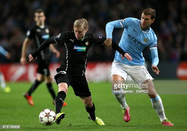 Manchester City's Edin Dzeko and Plzen's Frantisek Rajtoral battle for the ball
