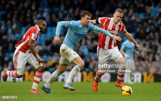 Manchester City's Edin Dzeko battles for the ball with Stoke City's Ryan Shawcross and Wilson Palacios during the Barclays Premier League match at...