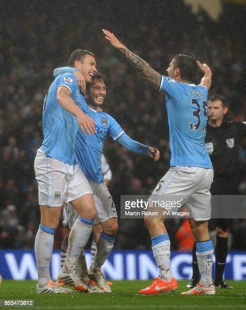 Manchester City's Edin Dzeko celebrates scoring his teams second goal of the game with teammates David Silva and Stevan Jovetic