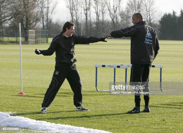 Manchester City's Elano pretends to throw a snowball at Vincent Kompany during the training session at Carrington Training Ground Manchester