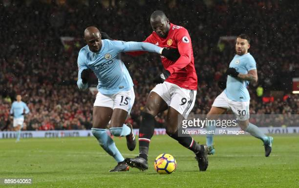Manchester City's Eliaquim Mangala and Manchester United's Romelu Lukaku battle for the ball during the Premier League match at Old Trafford...