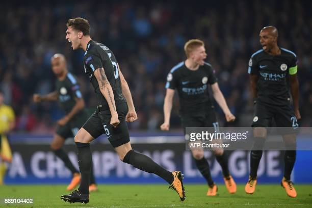 Manchester City's English defender John Stones celebrates after scoring during the UEFA Champions League football match Napoli vs Manchester City on...