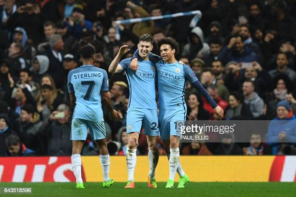 Manchester City's English defender John Stones celebrates scoring their fourth goal during the UEFA Champions League Round of 16 firstleg football...