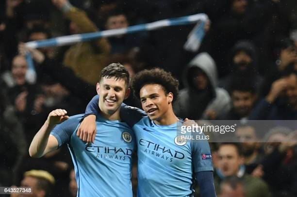 Manchester City's English defender John Stones celebrates scoring their fourth goal with Manchester City's German midfielder Leroy Sane during the...