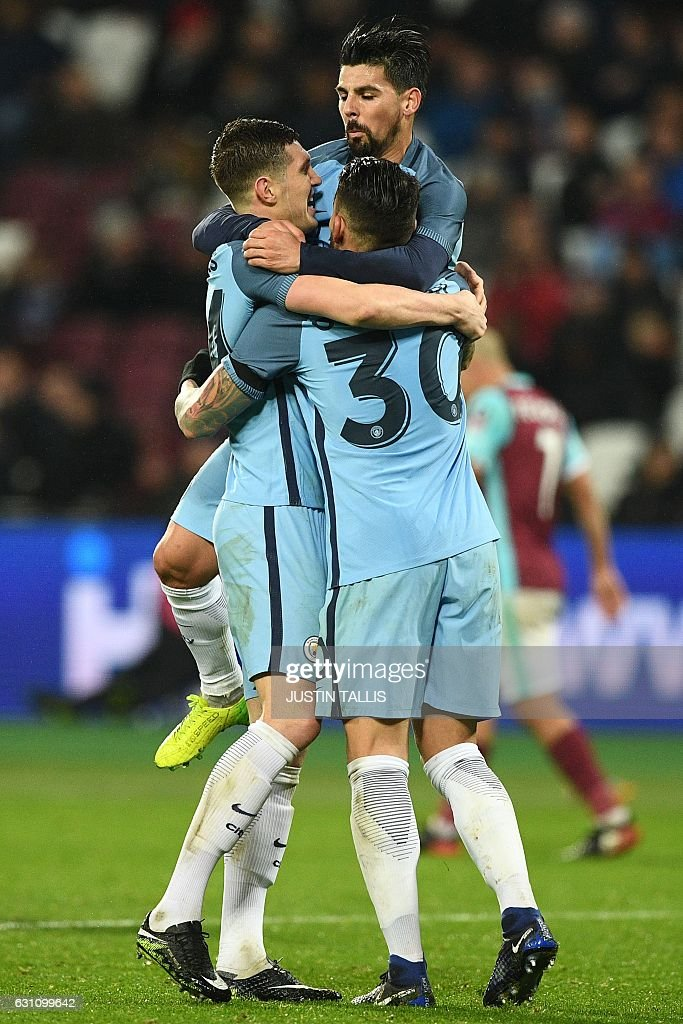 Manchester City's English defender John Stones (L) celebrates with teammates after scoring their fifth goal during the English FA cup third round football match between West Ham United and Manchester City at the London Stadium in east London on January 6, 2017. / AFP / Justin TALLIS / RESTRICTED TO EDITORIAL USE. No use with unauthorized audio, video, data, fixture lists, club/league logos or 'live' services. Online in-match use limited to 75 images, no video emulation. No use in betting, games or single club/league/player publications. /
