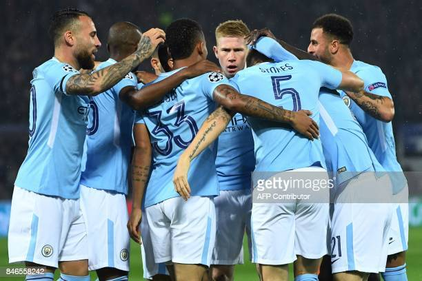 Manchester City's English defender John Stones celebrates with teammates after scoring a goal during the UEFA Champions League Group F football match...