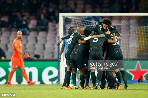 Manchester City's English defender John Stones celebrates with teammates after scoring during the UEFA Champions League football match Napoli vs...