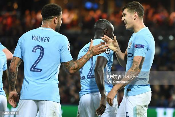 Manchester City's English defender John Stones celebrates with Manchester City's English defender Kyle Walker after scoring his second goal during...