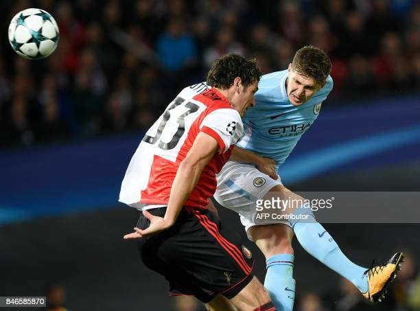 Manchester City's English defender John Stones heads the ball and scores a goal during the UEFA Champions League Group F football match between...