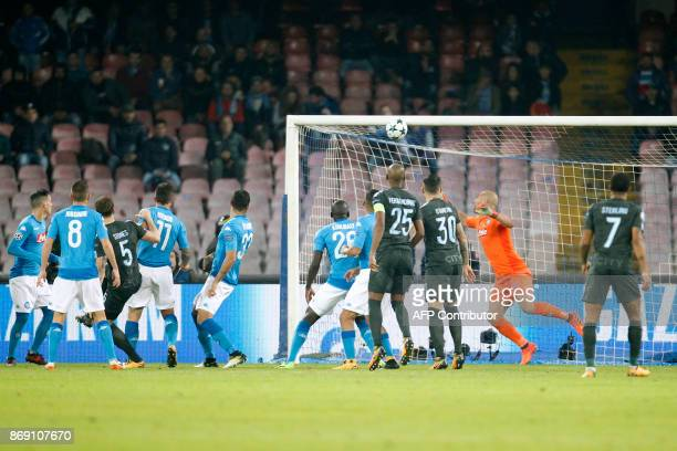 Manchester City's English defender John Stones scores during the UEFA Champions League football match Napoli vs Manchester City on November 1 2017 at...