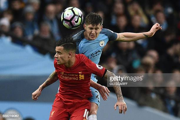 Manchester City's English defender John Stones vies with Liverpool's Brazilian midfielder Philippe Coutinho during the English Premier League...