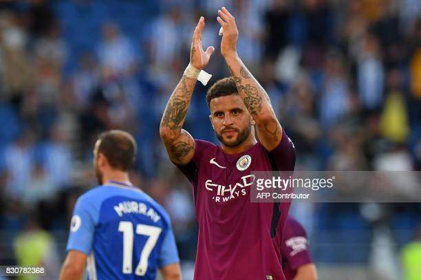 Manchester City's English defender Kyle Walker applauds supporters after the English Premier League football match between Brighton and Hove Albion...