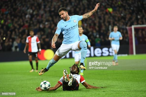 Manchester City's English defender Kyle Walker jumps over Feyenoord's Dutch defender Miquel Nelom during the UEFA Champions League Group F football...