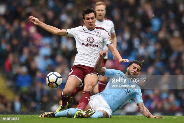 Manchester City's English defender Kyle Walker vies with Burnley's English midfielder Jack Cork during the English Premier League football match...