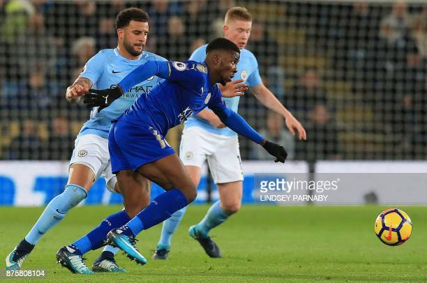 Manchester City's English defender Kyle Walker vies with Leicester City's Nigerian striker Kelechi Iheanacho during the English Premier League...