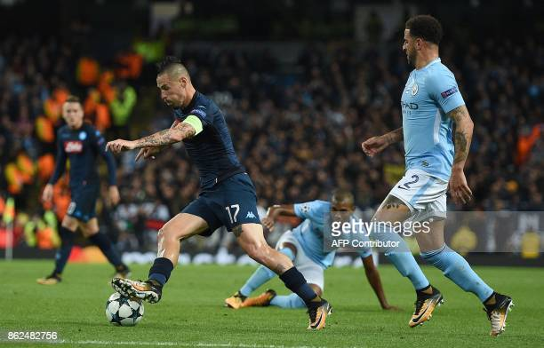 Manchester City's English defender Kyle Walker vies with Napoli's Slovakian midfielder Marek Hamsik during the UEFA Champions League Group F football...