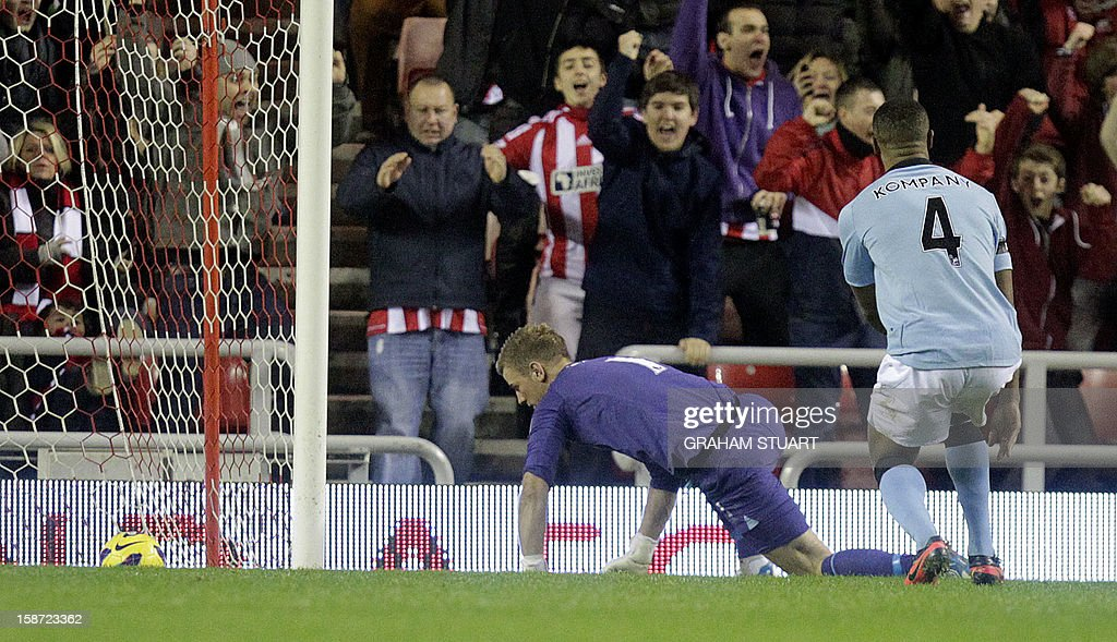 """Manchester City's English goalkeeper Joe Hart (L) and Manchester City's Belgian defender Vincent Kompany (R) look on at the ball in the back of the net after Sunderland's English midfielder Adam Johnson (unseen) scored the opening goal during the English Premier League football match between Sunderland and Manchester City at The Stadium of Light in Sunderland, north-east England on December 26, 2012. USE. No use with unauthorized audio, video, data, fixture lists, club/league logos or """"live"""" services. Online in-match use limited to 45 images, no video emulation. No use in betting, games or single club/league/player publications."""