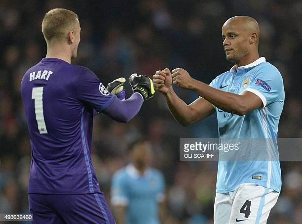 Manchester City's English goalkeeper Joe Hart and Manchester City's Belgian defender Vincent Kompany celebrates after winning a UEFA Champions league...