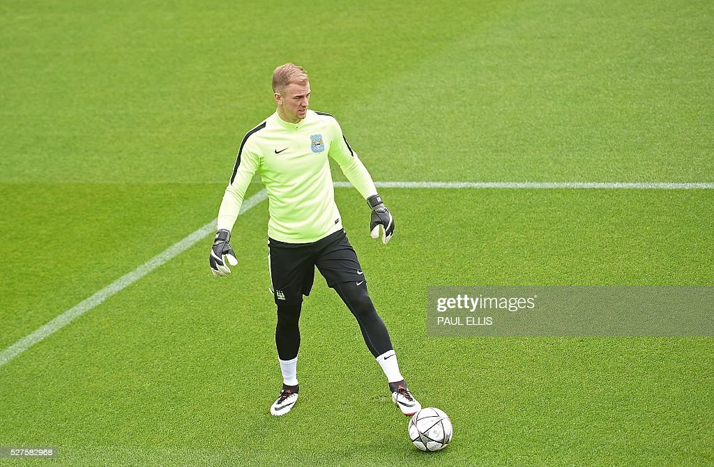 Manchester City's English goalkeeper Joe Hart attends a team training session at the City Academy in Manchester, north west England, on May 3, 2016. Manchester City will play against Real Madrid CF in a UEFA Champions League semi-final second leg football match in Madrid on May 4. / AFP / PAUL