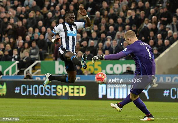 Manchester City's English goalkeeper Joe Hart clears the ball as Newcastle United's French midfielder Moussa Sissoko closes in during the English...